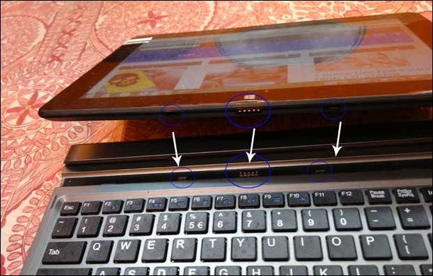 Tablet screen of Latab rests on 2 magnetic connecters and middle connecter supports data transfer between keyboard and screen